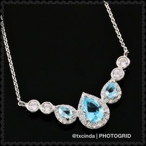 Blue Topaz and White Sapphire Pendant Necklace